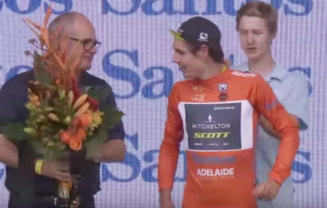 Daryl Impey gets some flowers of some bloke in glasses (via YouTube)